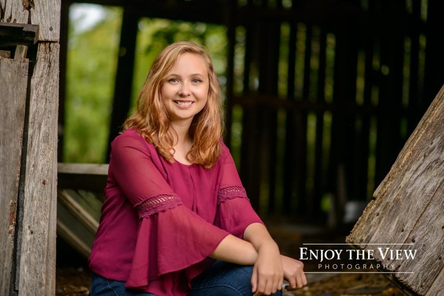 senior girl near barn
